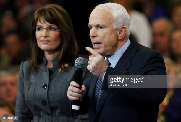 Republican presidential candidate Sen John McCain speaks as Republican vicepresidential candidate Alaska Gov Sarah Palin listens during a town hall...