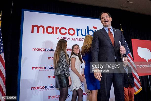 Republican presidential candidate Sen Marco Rubio acknowledges the crowd after addressing supporters at a caucus night party at the Marriott hotel on...