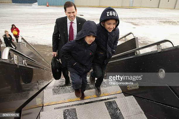 Republican presidential candidate Sen Marco Rubio and his sons Anthony and Dominick board their chartered plane before departing from...
