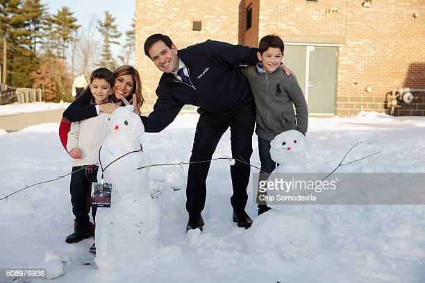 Republican presidential candidate Sen Marco Rubio and his wife Jeanette Dousdebes Rubio pose for a photograph with their sons Dominick and Anthony...