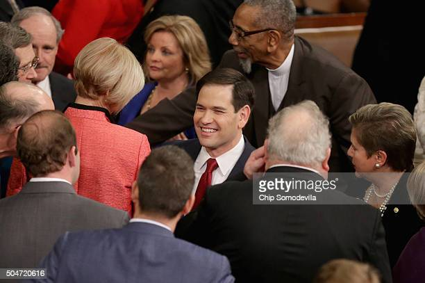 Republican presidential candidate Sen. Marco Rubio arrives before US President Barack Obama delivers the State of the Union speech before members of...