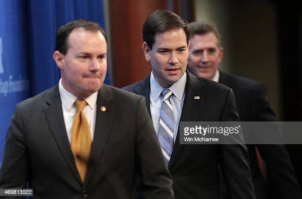 Republican presidential candidate Sen Marco Rubio arrives with Sen Mike Lee and former Sen Jim DeMint before speaking at the Heritage Foundation...