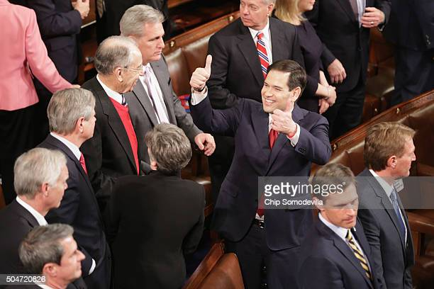 Republican presidential candidate Sen Marco Rubio gives a thumbs up to members of congress before US President Barack Obama delivers the State of the...