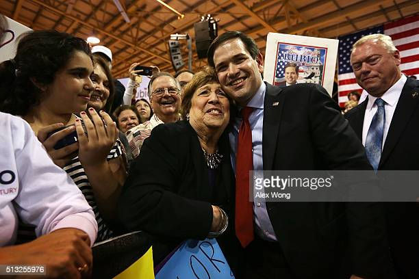 Republican presidential candidate Sen Marco Rubio greets supporters during a rally at Tropical Park March 1 2016 in Miami Florida Eyeing a mustwin in...