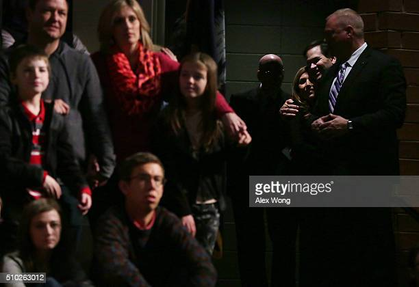 Republican presidential candidate Sen Marco Rubio hugs his wife Jeanette Dousdebes Rubio before he speaks to voters during a campaign rally February...