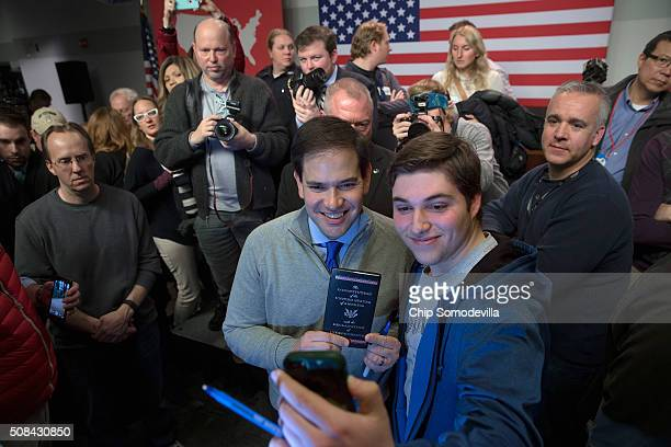 Republican presidential candidate Sen Marco Rubio poses for a selfie while holding a copy of the US Constitution and the Declaration of Independence...