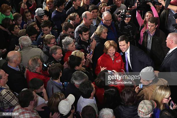 Republican presidential candidate Sen Marco Rubio poses for a photograph with a supporter at the conclusion of a campaign rally in the Exeter Town...