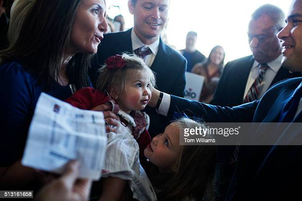 Republican presidential candidate Sen Marco Rubio RFla greets Juliana Hennen 18 months during a campaign rally at McGhee Tyson Airport in Alcoa Tenn...