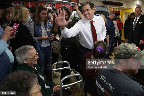 Republican presidential candidate Sen Marco Rubio says goodbye to employees at Globe Manufacturing following a tour and questionandanswer session...
