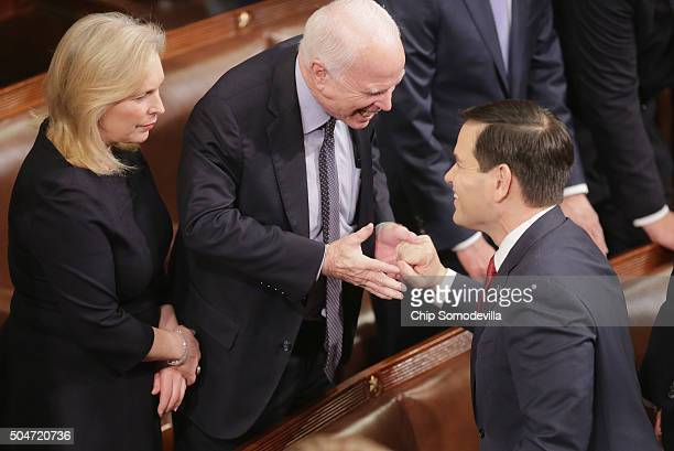Republican presidential candidate Sen Marco Rubio shakes hands with Senator John McCain as Sen Kirsten Gillibrand looks on before US President Barack...