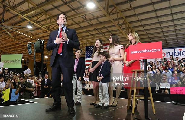Republican presidential candidate Sen Marco Rubio speaks as daughters Amanda and Daniella son Anthony and Dominick and wife Jeanette Dousdebes Rubio...
