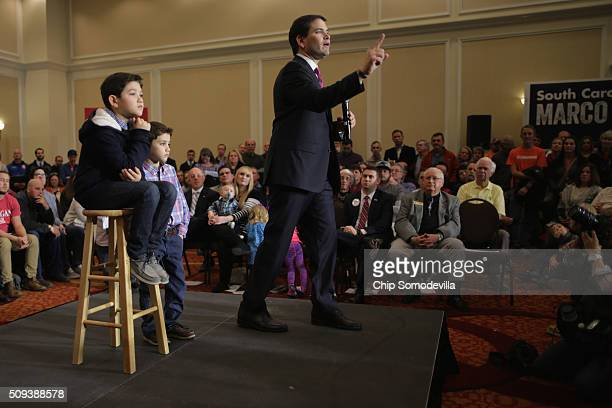 Republican presidential candidate Sen Marco Rubio speaks during a campaign rally with his sons Anthony and Dominick at the Marriott hotel February 10...