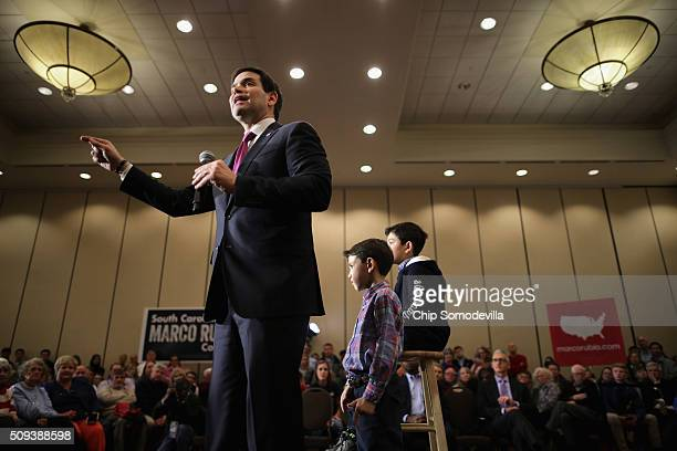 Republican presidential candidate Sen Marco Rubio speaks during a campaign rally with his sons Anthony 10 and Dominick at the Marriott hotel February...