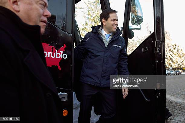 Republican presidential candidate Sen Marco Rubio steps off his campaign bus outside the polling place at Webster School to thank supporters February...