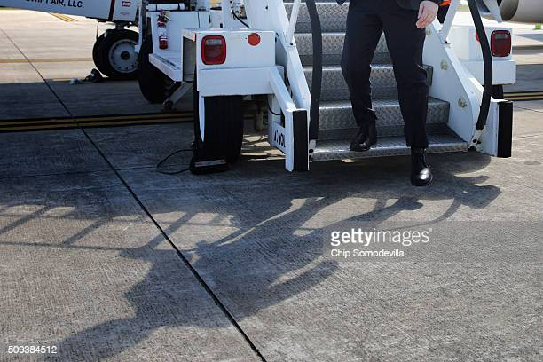 Republican presidential candidate Sen Marco Rubio steps off his charter airplane after arriving from Manchester New Hampshire February 10 2016 in...