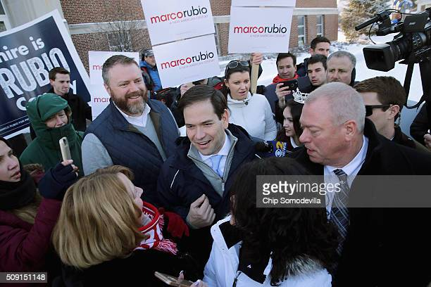 Republican presidential candidate Sen Marco Rubio thanks supporters outside the polling place at Webster School February 9 2016 in Manchester New...