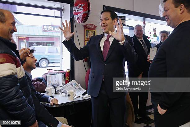 Republican presidential candidate Sen Marco Rubio visits with about 50 customers at the Norton's Classic Cafe during a campaign stop February 8 2016...