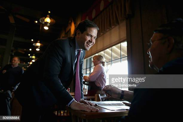 Republican presidential candidate Sen Marco Rubio visits with diners while stopping for lunch at the Cracker Barrel Old Country restaurant February...