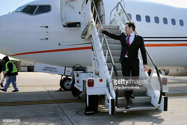 Republican presidential candidate Sen Marco Rubio waves as he steps off his charter airplane after arriving from Manchester New Hampshire February 10...