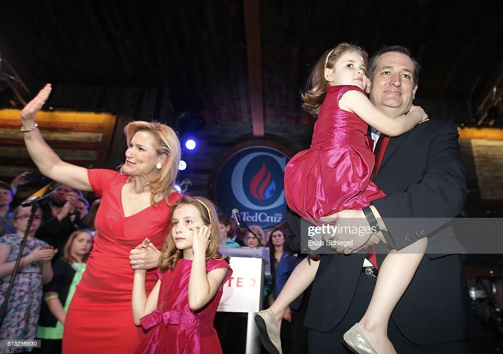 Republican presidential candidate, Sen. Ted Cruz (R-TX) celebrates holding his daughter Catherine with his wife Heidi and daughter Caroline during a Super Tuesday watch party at the Redneck Country Club March 1, 2016 in Stafford, Texas. Cruz won the Texas, Oklahoma, and Alaska primaries.