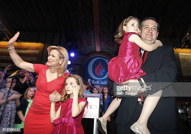 Republican presidential candidate Sen Ted Cruz celebrates holding his daughter Catherine with his wife Heidi and daughter Caroline during a Super...