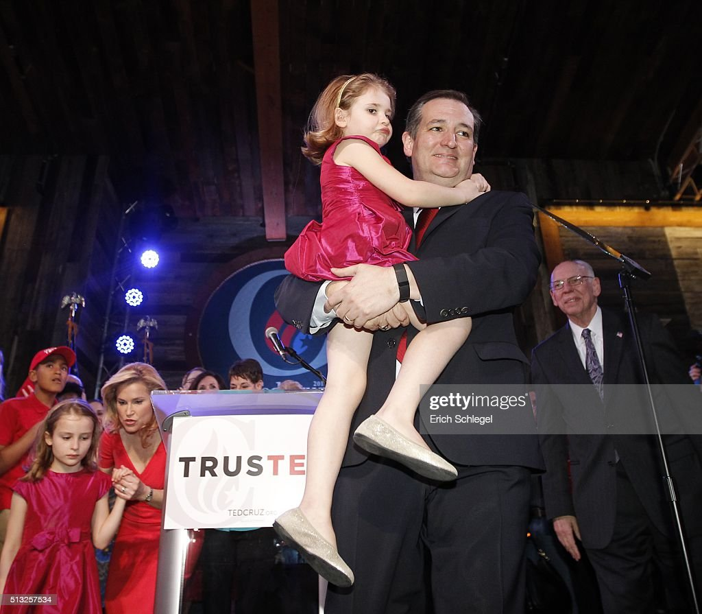 Republican presidential candidate, Sen. Ted Cruz (R-TX) celebrates, holding his daughter Catherine with his wife Heidi and other daughter Caroline during a Super Tuesday watch party at the Redneck Country Club March 1, 2016 in Stafford, Texas. Cruz won the Texas, Oklahoma, and Alaska primaries.