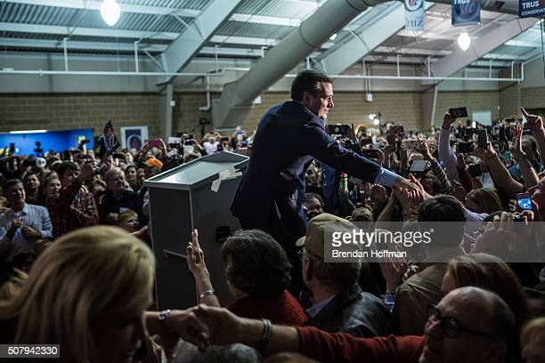 Republican presidential candidate Sen Ted Cruz greets audience members before speaking at a caucus night rally on February 1 2016 in Des Moines Iowa...