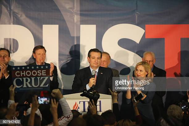 Republican presidential candidate Sen Ted Cruz stands with his wife Heidi as he addresses supporters at the caucus night gathering at the Iowa State...