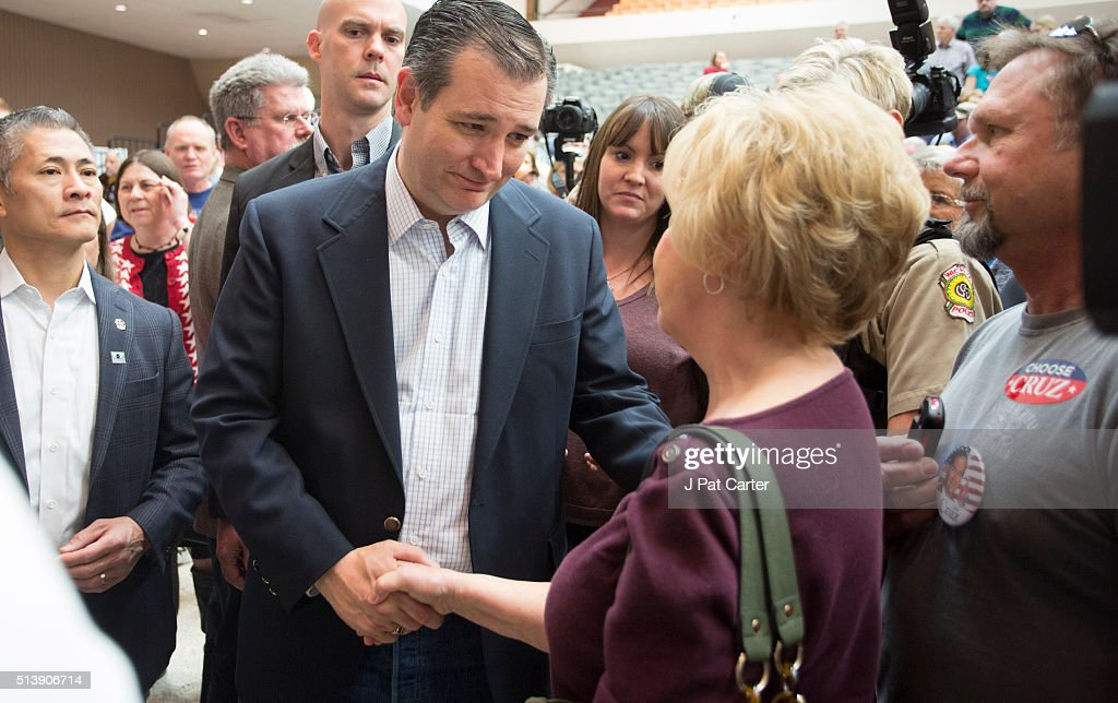 Republican presidential candidate Ted Cruz greets a woman at a campaign rally on March 5, 2016 in Wichita, Kansas The Republican party is holding its state wide caucus in several locations.
