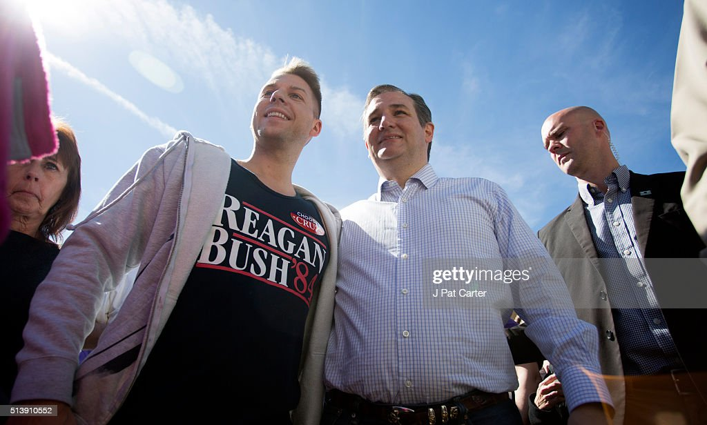 Republican presidential candidate Ted Cruz (R) poses for a photo at a campaign rally on March 5, 2016 in Wichita, Kansas The Republican party is holding its state wide caucus in several locations.