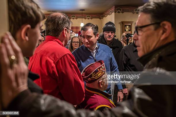 Republican presidential candidate Ted Cruz talks with audience members after a campaign event at Bogie's Steakhouse on January 26 2016 in Albia Iowa...