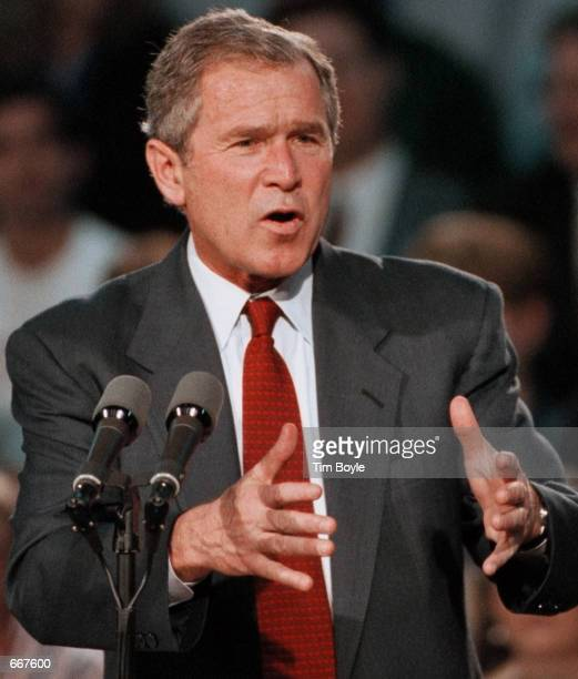 Republican presidential candidate Texas Gov George W Bush speaks during a campaign stop October 24 2000 at Thomas Middle School in Arlington Heights...