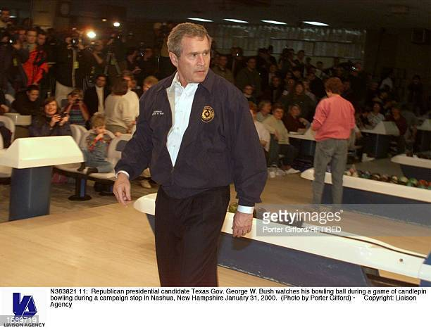 Republican presidential candidate Texas Gov George W Bush watches his bowling ball during a game of candlepin bowling during a campaign stop in...