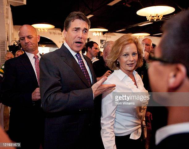 Republican presidential candidate Texas Gov Rick Perry arrives with his wife Anita to the Lincoln Day Dinner hosted by the Black Hawk County...