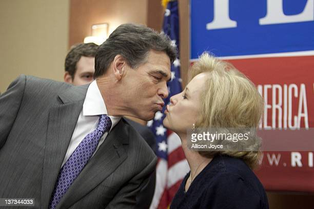 Republican presidential candidate Texas Gov Rick Perry kisses his wife Antia at the end of a news conference at Hyatt Place January 19 2012 in North...