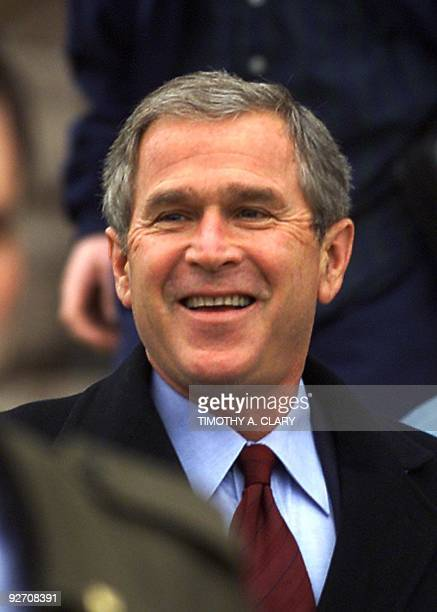 Republican presidential candidate Texas Governor George W Bush smiles as he leaves the Texas State Capitol 13 December 2000 the morning after he won...