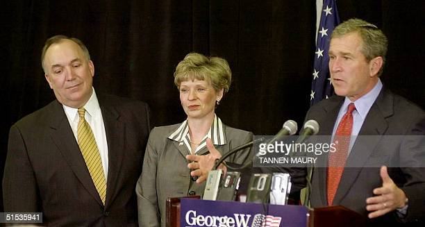 Republican presidential candidate Texas Governor George W Bush speaks at a news conference 11 January 2000 in Grand Rapids MI joined by Michigan...