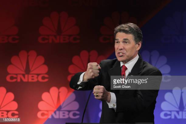 Republican presidential candidate Texas Governor Rick Perry answers a question during a debate hosted by CNBC and the Michigan Republican Party at...