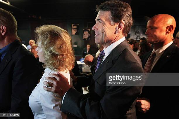 Republican presidential candidate Texas Governor Rick Perry arrives with his wife Anita at the Black Hawk County GOP's Lincoln Day Dinner August 14...