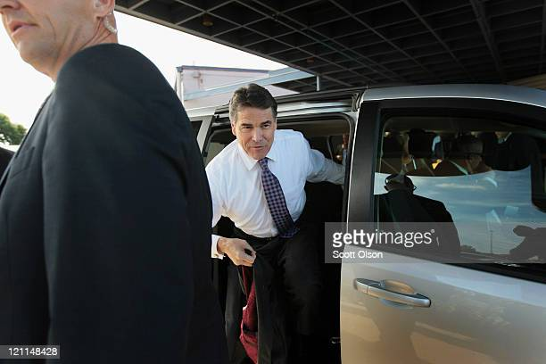 Republican presidential candidate Texas Governor Rick Perry arrives at the Black Hawk County GOP's Lincoln Day Dinner August 14 2011 in Waterloo Iowa...