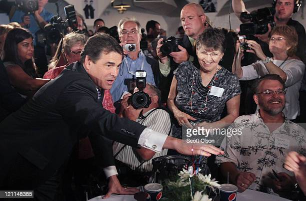 Republican presidential candidate Texas Governor Rick Perry greets guests at the Black Hawk County GOP's Lincoln Day Dinner August 14 2011 in...