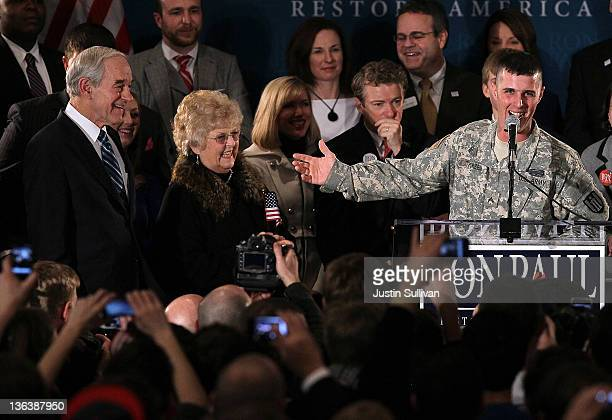 Republican presidential candidate US Rep Ron Paul and his wife Carol Paul look on as US Army Corp Jesse Thorsen speaks during a rally on the night of...