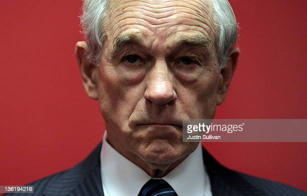 Republican presidential candidate US Rep Ron Paul looks on before the start of a town hall meeting at the Iowa Speedway on December 28 2011 in Newton...
