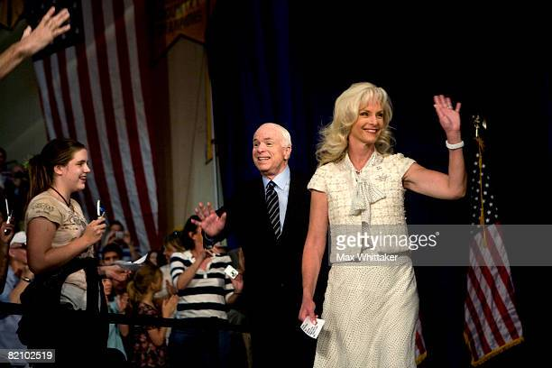 Republican presidential candidate U.S. Sen. John McCain and his wife Cindy McCain walk into a town hall meeting at Reed High School July 29, 2008 in...