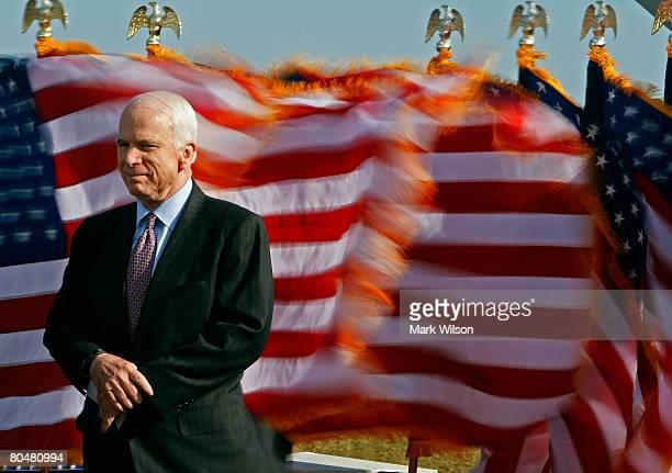 Republican presidential candidate US Sen John McCain listens to his introduction before speaking at the Navy and Marine Corps Memorial Stadium April...