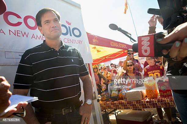 Republican presidential candidate US Sen Marco Rubio pauses to speak to reporters while greeting fans outside Jack Trice Stadium before the start of...