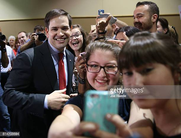 Republican presidential candidate US Sen Marco Rubio takes pictures with poeple as he greets people during a campaign rally at theTampa Convention...