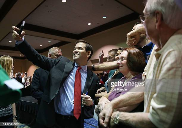 Republican presidential candidate US Sen Marco Rubio takes selfies as he greets people during a campaign rally at theTampa Convention Center on March...