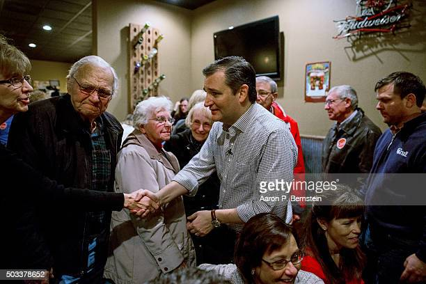 Republican presidential candidate US Sen Ted Cruz greets supporters Charlie's Steakhouse on January 4 2016 in Carroll Iowa Cruz began a sixday bus...