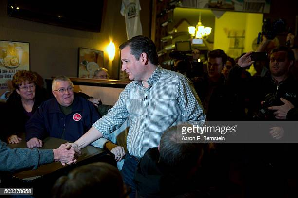 Republican presidential candidate US Sen Ted Cruz greets supporters at Charlie's Steakhouse on January 4 2016 in Carroll Iowa Cruz began a sixday bus...
